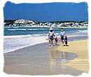 Family enjoying a beach holiday in South Africa