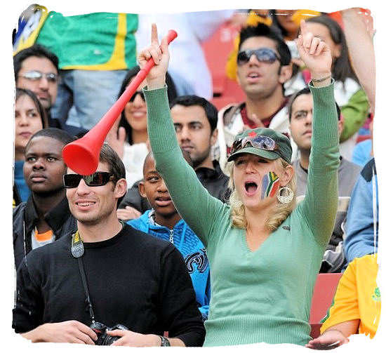 Cheering supporter of the South African football team, holding a Vuvuzela trumpet - Soccer in South Africa, Bafana Bafana South African Soccer Team