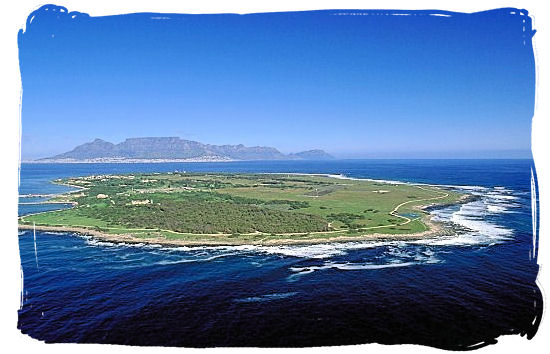 Aerial view of Robben Island with Table Mountain on the horizon - Amazing Robben Island tour, visit Nelson Mandela prison cell