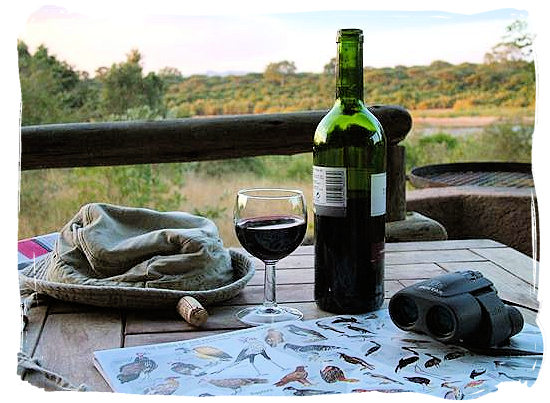 On the deck of one of the semi-luxury Safari tents at rest camp, enjoying a good south African wine - Lower Sabie Rest Camp in the Kruger National Park, South Africa