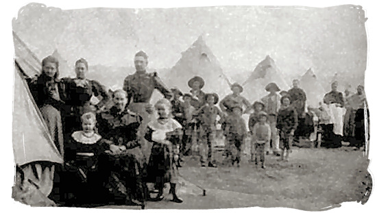 Boer woman and children in a British concentration camp waiting for rations - Anglo Boer War in South Africa