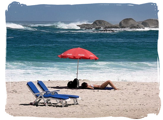 Blissful basking in the sun on Camps Bay's famous beach - Cape Town holiday attractions, Table Mountain National Park