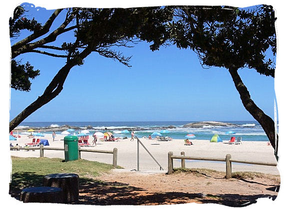 Camps Bay a place with glorious white sandy beaches fringed by palm trees, with a trendy nightlife