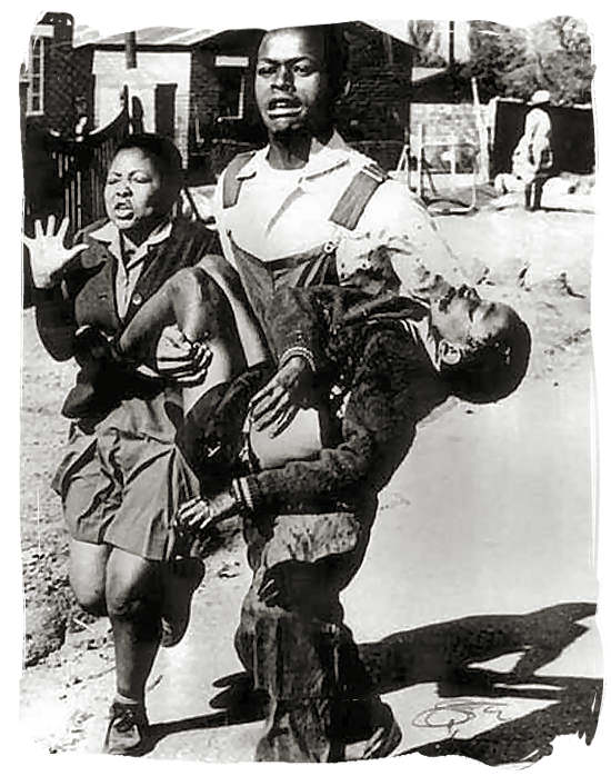 Famous photograph by Sam Nzima of the Soweto Uprising showing a student carrying the body of 12 year old Hector Pieterson, one of the first casualties - History of Apartheid in South Africa