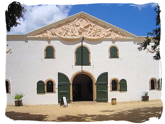 Cloete Cellar building, the original wine cellar at the estate. The pediment gable is by the sculptor Anton Anreith - Groot Constantia, the Oldest South Africa Wine Country Estate