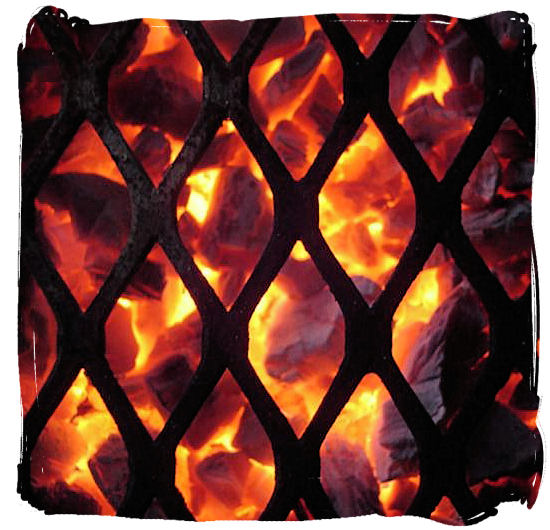 Great coals from a wood fire, almost ready for the braai - South African barbecue tips and ideas