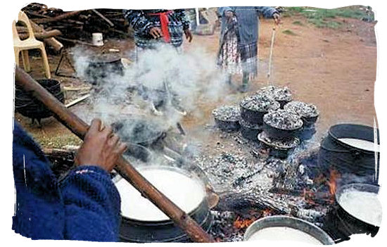 Cooking mieliepap in a pot, as in the days of old - South Africa's Traditional African Food
