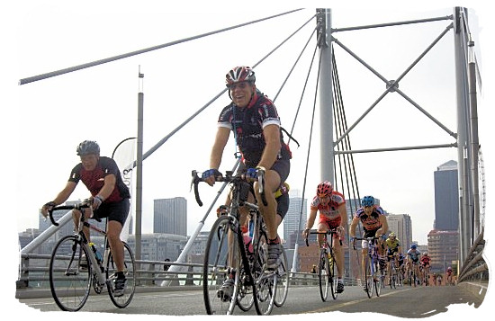 Cyclists crossing the Nelson Mandela Bridge in the city centre of Johannesburg in the 94,7 Highveld cycle Challenge - South Africa Sports Top Ten South African Sports
