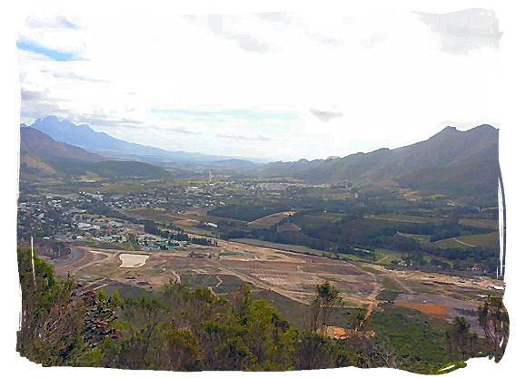 The famous Franschhoek valley, wine heartland of South Africa hemmed in by towering mountains, with the town of Franschhoek  - The French Huguenots and the Huguenot Museum in South Africa