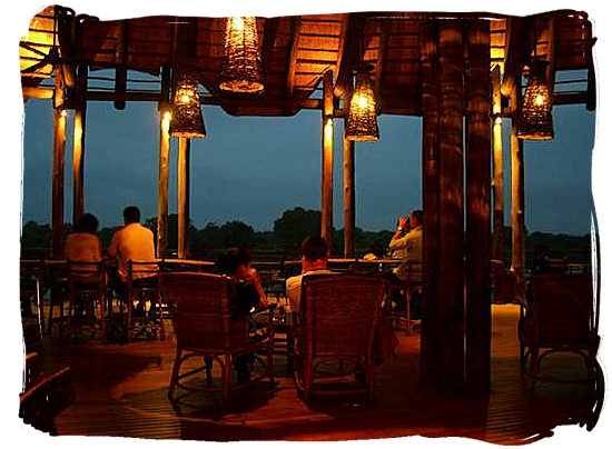 Relaxing after dinner on the deck at the camp,s restaurant - Lower Sabie Rest Camp in the Kruger National Park, South Africa