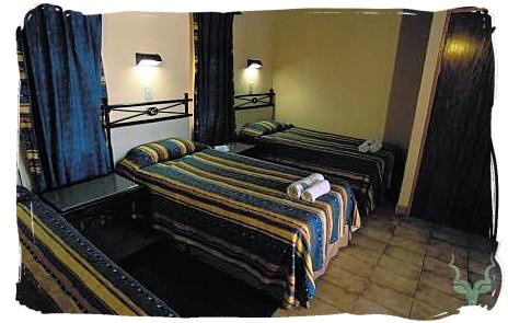 Bedroom of a guest cottage at Shimuwini bushveld camp, Kruger National Park