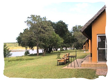 Guest cottages overlooking the dam at Shimuwini bushveld camp, Kruger National Park