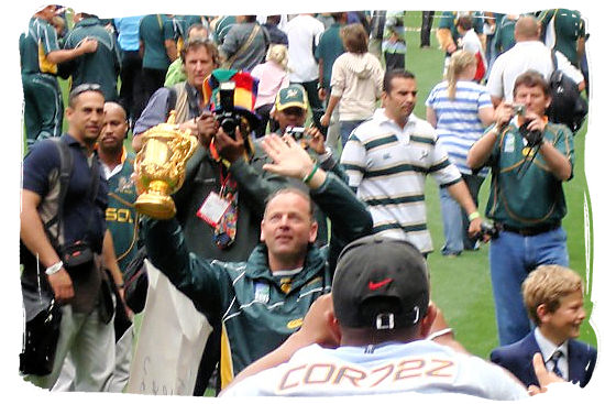 Jake White trainer and coach of the victorious 2007 Springbok team proudly shows the William Webb Ellis world cupTrophy to a sea of Springbok supporters at the Newlands Rugby Stadium in Cape Town - Springbok rugby in South Africa and the South Africa rugby team