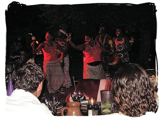 Indigenous african dancers performing in one of the Moyo traditional African restaurants - South Africa's Traditional African Food
