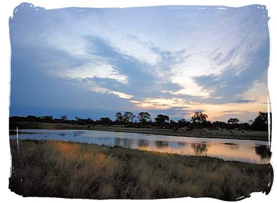 Sunset game drive near a dam