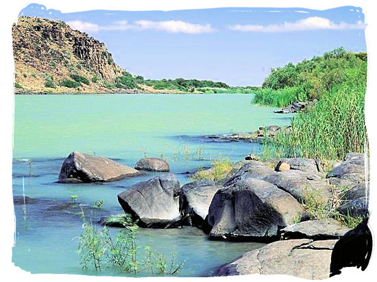 The mighty Orange river flowing wide and slowly below the Vanderkloof Dam