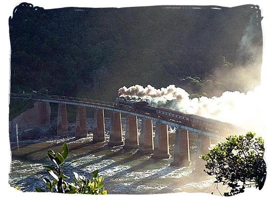 The Outeniqua Choo Tjoe steam train on the Kaaiman's river bridge near Wilderness