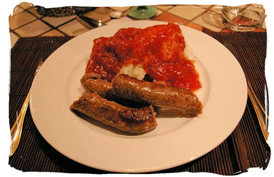 Mieliepap (maize porridge), boerewors (farmer sausage) and sous (sauce) - South African food adventure, South Africa food