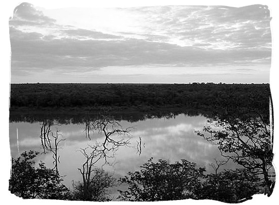 Early dawn over Pioneer dam at Mopani camp