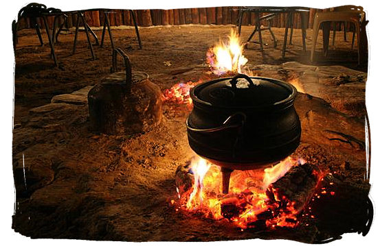 Cooking potjiekos (pot food)over an open fire, highly popular with all South Africa cultures - food in South Africa.