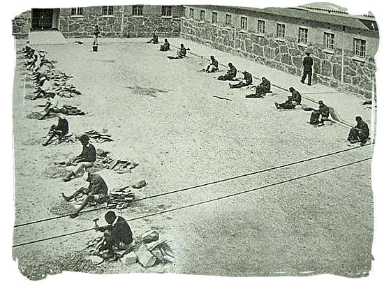 Poster at the Robben Island museum of prisoners chipping stones in the courtyard of Robben Island prison