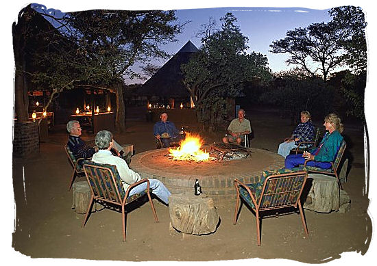 Relaxing around the camp fire after an exciting safari day