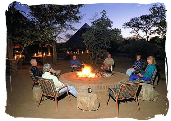 Relaxing around the camp fire - Sirheni Bushveld Camp, Kruger National Park Safari, South Africa