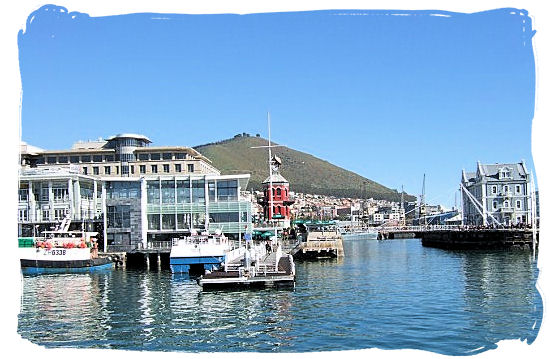 View of the Robben Island Information centre and embarkation jetty from the ferry that has just departed - Victoria & Alfred Waterfront Cape Town, Table Mountain Backdrop
