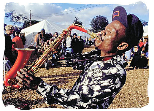 Saxophone player at the Grahams town festival - South African Music, a Fusion of South Africa Music Cultures
