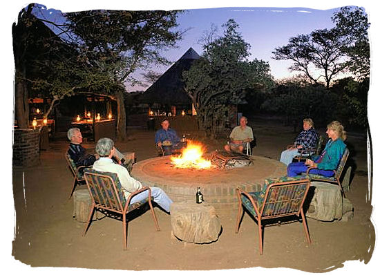 Socializing around the barbecue fire before and after the braai (barbecue) is typically South African - South African traditional food