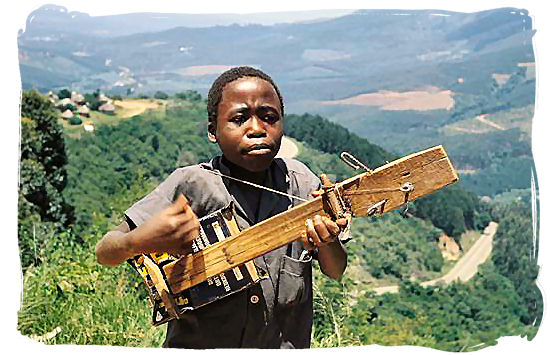 Northern Sotho (BaPedi) youngster playing his homemade guitar - Black People in South Africa, Black Population in South Africa