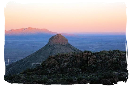 The sun is setting overt Spandou kop (hill) - Camdeboo National Park (previously Karoo Nature Reserve
