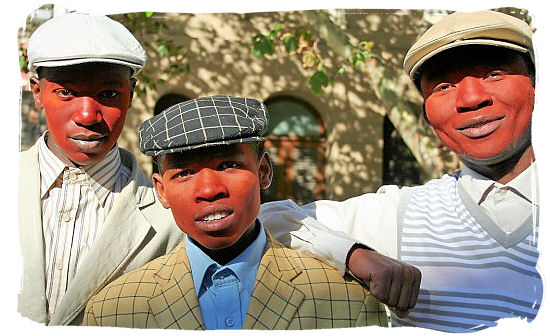 After initiates have passed into manhood, they smear red clay on their faces to celebrate - Xhosa Tribe, Xhosa Language and Xhosa Culture in South Africa