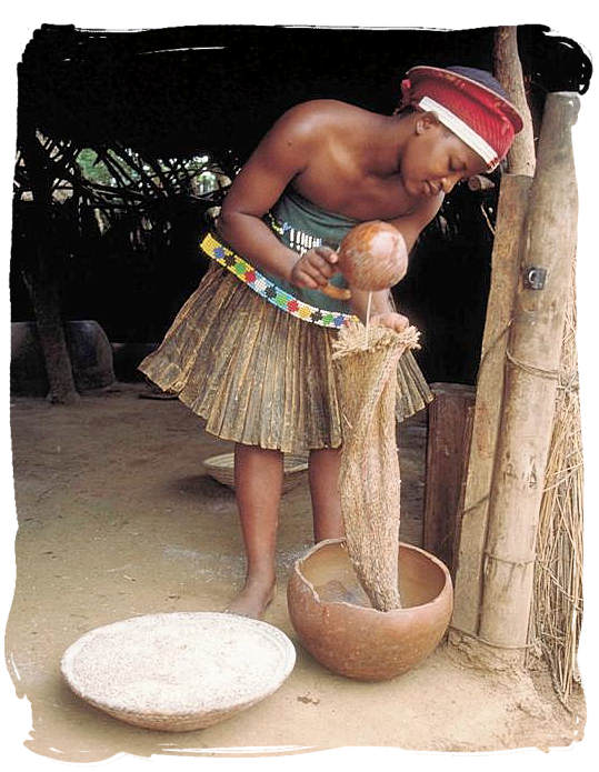Zulu lady making traditional African beer - South Africa's Traditional African Food