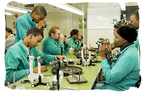 Trainee diamond polishers at the Harry Oppenheimer Diamond training school - South African national anthem