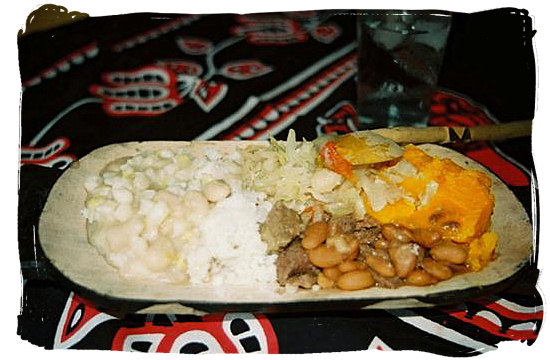 Typical Xhosa or Zulu dish consisting of samp, rice, beans, pumpkin and cabbage, almost like Umngwusho - South Africa's Traditional African Food