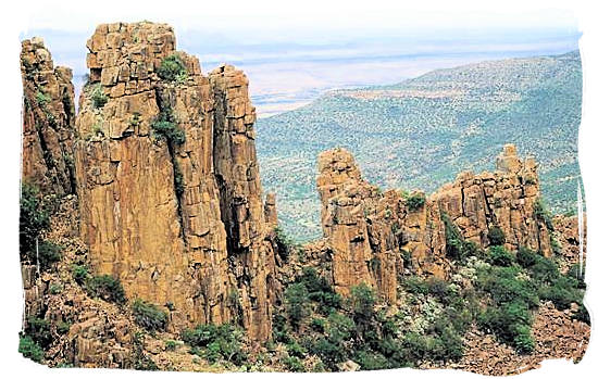 "Piled dolerites columns against the backdrop of the ""Valley of Desolation - Camdeboo National Park, Karoo Nature Reserve, South Africa"