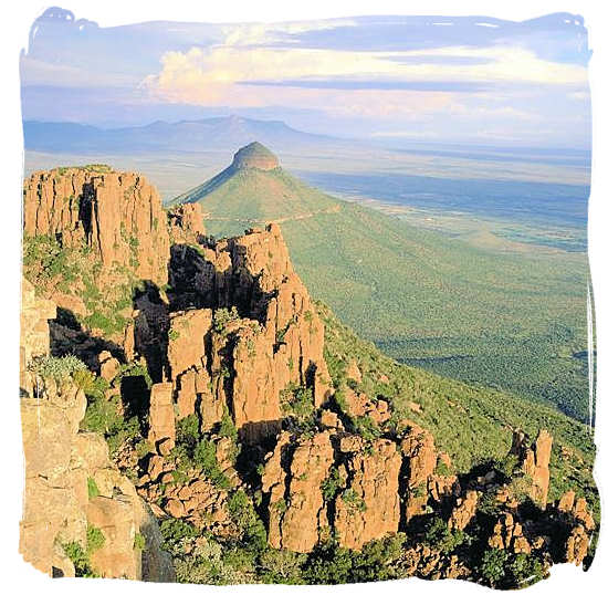 Huge rock columns with Spandou kop (hill) in the background in the valley of desolation - Camdeboo National Park, previously known as the Karoo Nature Reserve