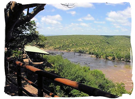 Olifants Restcamp, Kruger National Park, South Africa - View across the river from the perimeter of the camp with shaded lookout on the left