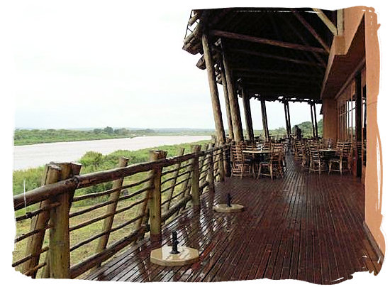 The deck around the restaurant and lounge bar area at the camp on a rainy day - Lower Sabie Rest Camp in the Kruger National Park, South Africa