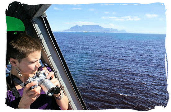 View of Table Mountain on the skyline from the legendary Bell UH-1 Huey helicopter - Activity Attractions in Cape Town South Africa and the Cape Peninsula