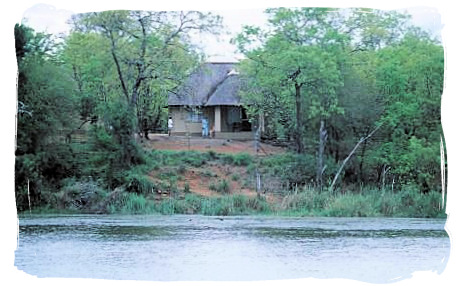 View of the camp from across the dam - Sirheni Bushveld Camp, Kruger National Park Safari, South Africa
