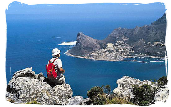 Hiker looking down at Hout Bay in the Cape Peninsula - South Africa Tours, Best Safari Tours of South Africa