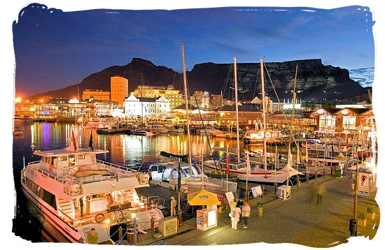 Victoria and Alfred Waterfront with the silhouette of table Mountain - Cape Town holiday attractions, Table Mountain National Park