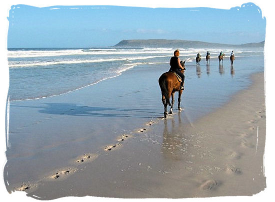 There's nothing quite like horse riding on the beach with the wind in your hair - Activity Attractions in Cape Town South Africa and the Cape Peninsula