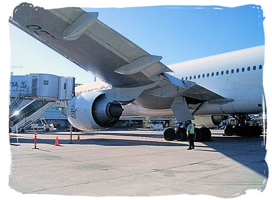 An Emirates Airlines airplane on the platform of Cape Town International Airport - Cheap Flights to Cape Town International Airport South Africa