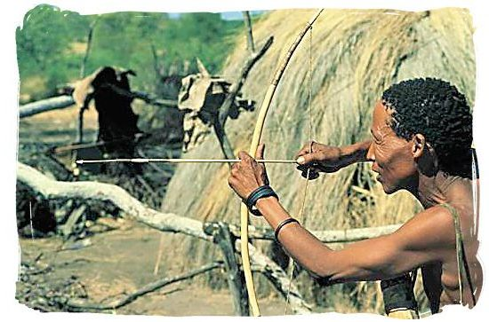 """Traditional hunting by a descendent of the ancient """"San"""" people - Kgalagadi Transfrontier Park in the Kalahari"""