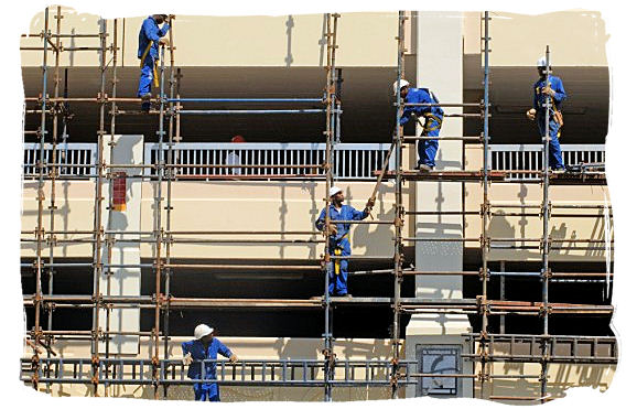 Construction of an upmarket residential development near the harbour in Durban - South African national anthem