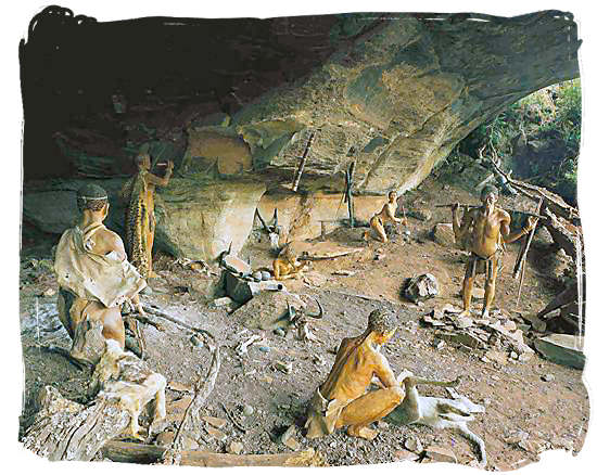 """Museum scene of ancient """"San"""" people using the Battle Cave in the beautiful Drakensberg mountains as their shelter - The Khoisan People, Blend of the Khoi and San people in South Africa"""