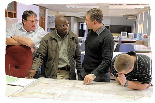 Management and surveyors discussing developments at Harmony Gold Mine - Best Jobs in South Africa, South African Jobs Search Engine